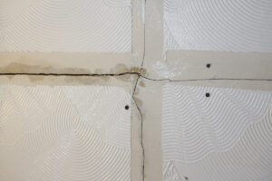 tear in Artex paint in the wall